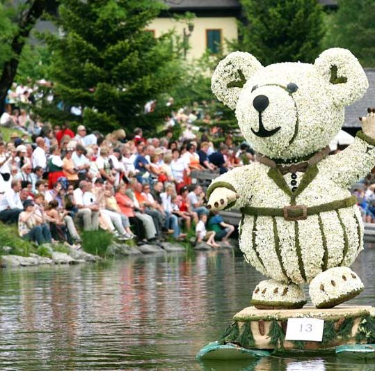 A float on the lake with a teddy bear of daffodills